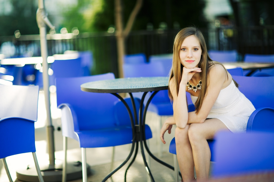 Allen High school Texas senior portraits at Waterscreek mall setting in pretty blue chairs