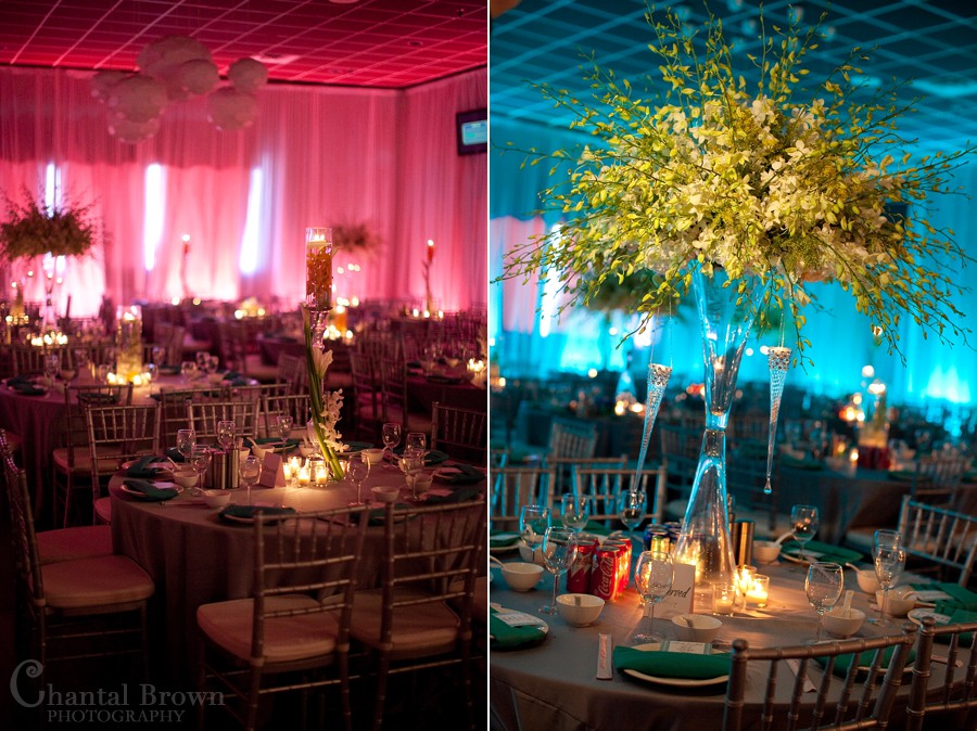Dallas wedding reception detailed flower centerpieces with pink and blue background light