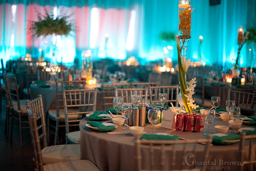 Dallas wedding reception beautiful detailed white calla lily flower centerpieces with blue background light