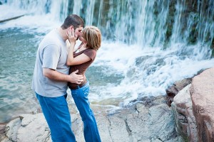 Medicine Park couple kissing by beautiful waterfall engagement in Lawton Oklahoma