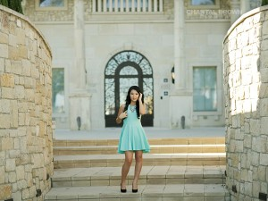 Gorgeous high school senior student standing in the middle of beautiful stone wall architecture taken at Adriatica village in McKinney Texas.