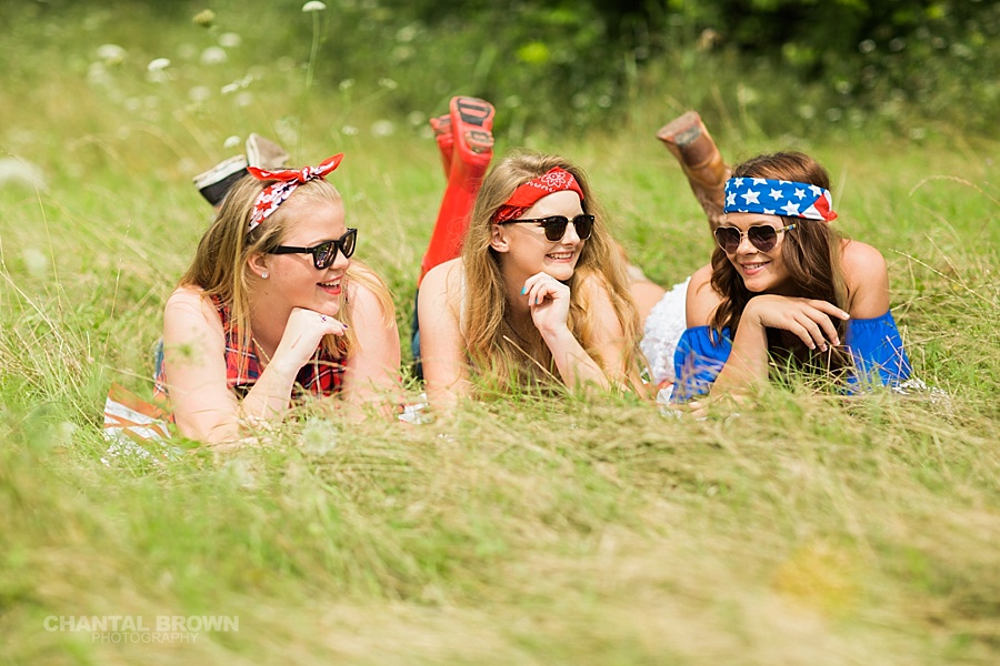 4th of July styled senior portraits group session in Dallas taken by Chantal Brown Photography during high noon in the grass field.