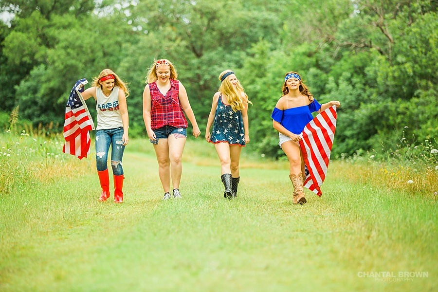 4th of July themed senior portraits group photo shoot in Dallas standing in big grass field taken by Chantal Brown Photography.