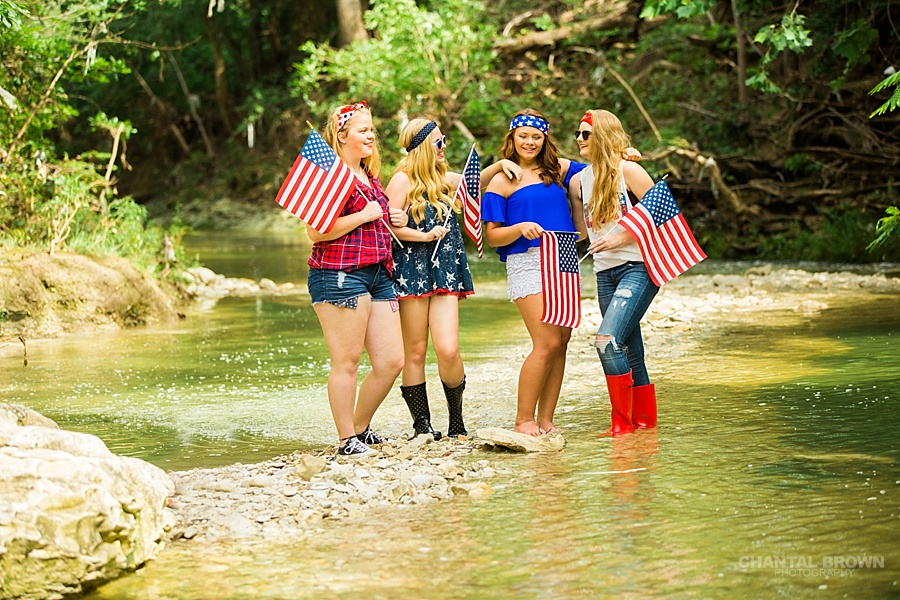 Happy 4th of July styled session in Dallas by water river creek holding American flags.