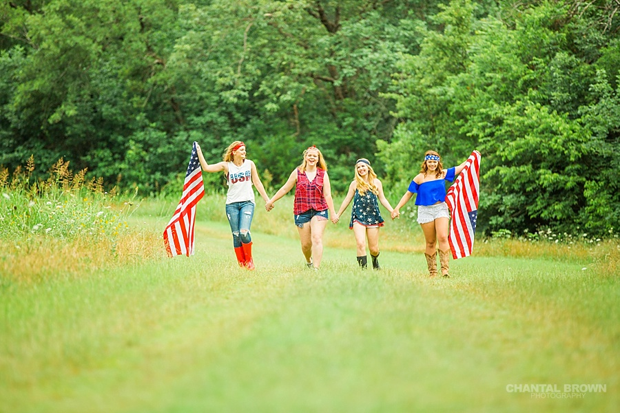 Happy July 4th in Dallas styled senior portraits group photo shoot holding American flags.
