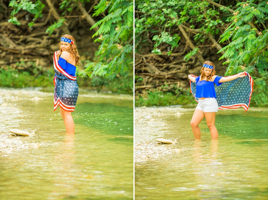 Standing in the water of Mesquite high school student wrapped around an American flag scarf themed photo shoot outdoor session in the water. This picture is taken by Dallas Chantal Brown Photography.