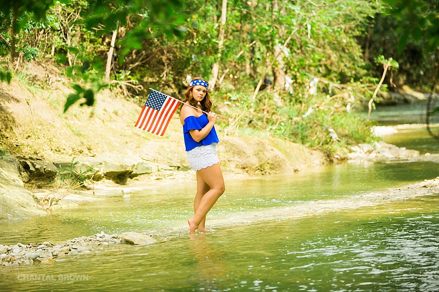 Let freedom ring in 4th of July inspiration styled senior portraits taken in Dallas in water creek river. She