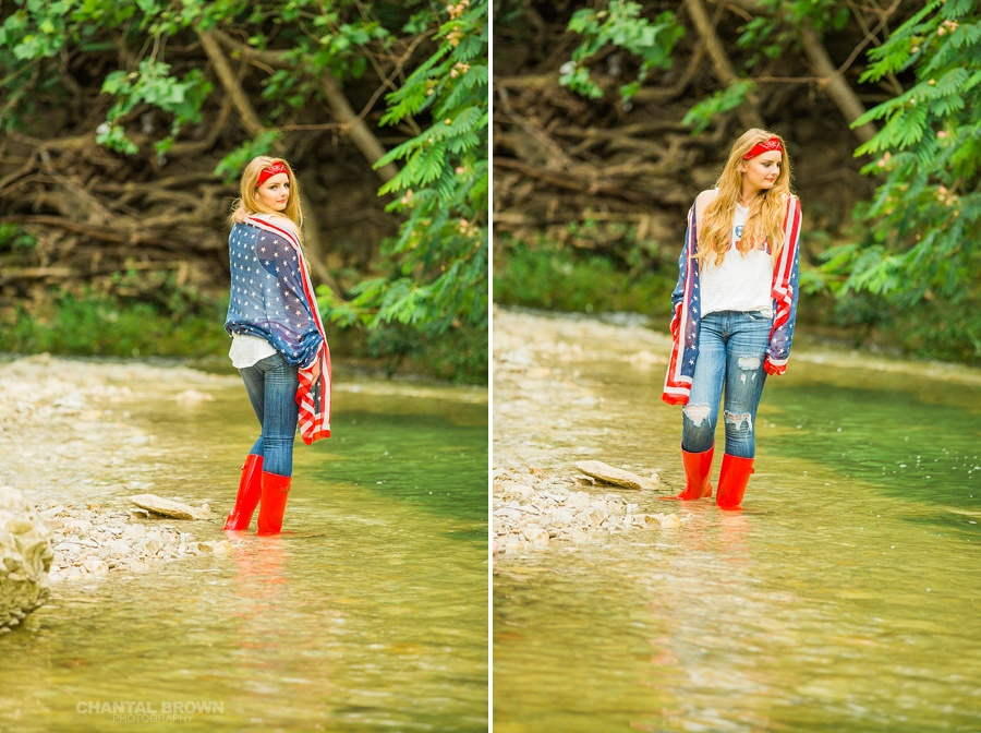 July 4th holding American flag scarf. This is a Dallas senior portraits styled photo shoot for a Plano high school student wearing a cute red boot in the water by the river. Taken by Dallas Chantal Brown Photography.