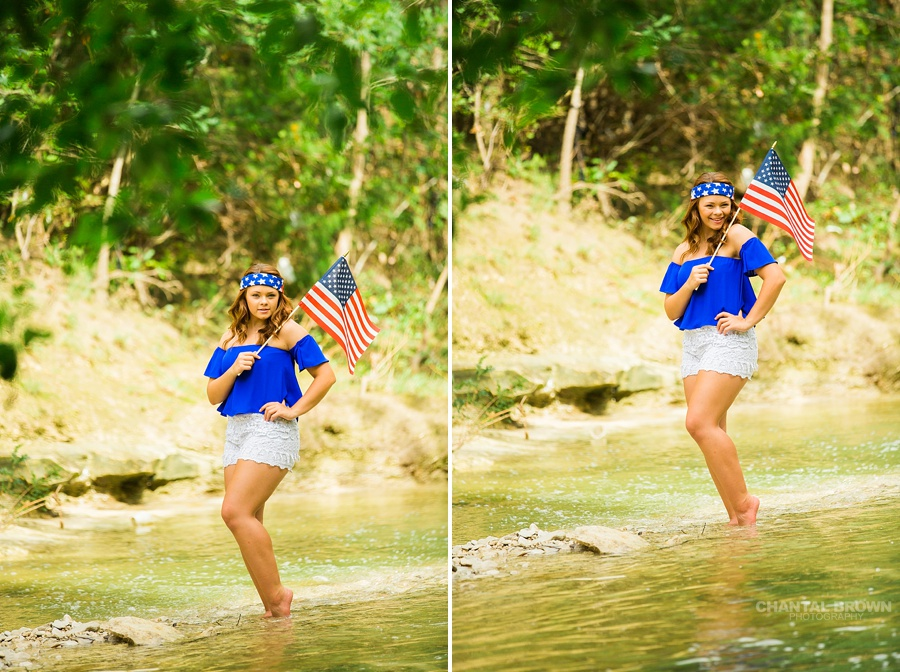 Very cute and patriotic outfit of a Dallas senior portraits and holding a small American flag standing in the water river creek outside. Taken by Dallas Chantal Brown Photography.