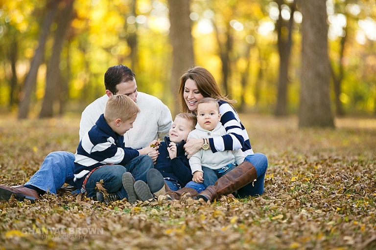 The greatest kids and parents family portrait taken in Dallas in the fall with gorgeous yellow leaves laughing by Chantal Brown Photography