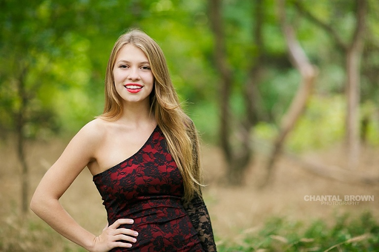 The best Addison Texas senior portrait photographer in Addison TX with a high school wearing pretty red dress in outdoor by Chantal Brown of Addison senior photographer.