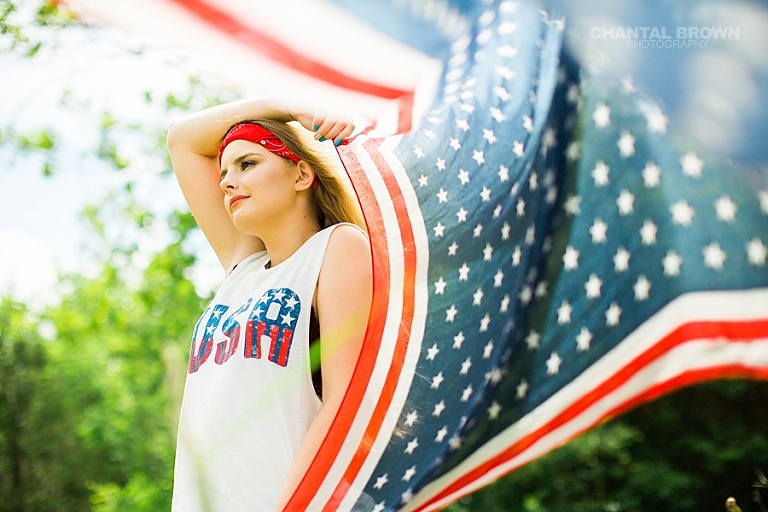 Happy Independence Day American Flag Dallas senior portraits holding a scarf outdoor field by Chantal Brown Photography. www.chantalbrownphotography.com